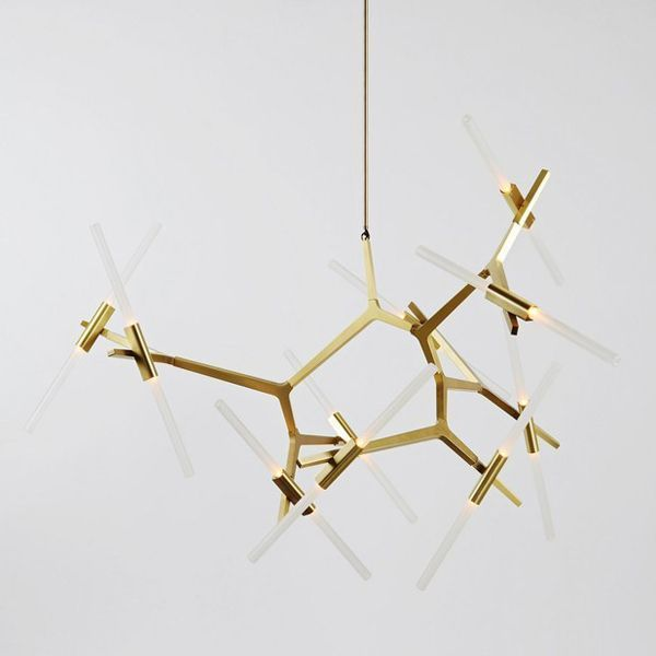 The Agnes Chandelier lamp with 20 points of light is a Lindsey Adelman design for the New York firm Roll & Hill. Agnes has a modular structure that allows different configurations ranging from a modest lamp, with 6 points of light to a large chandelier 20 points. The joints allow the bulbs to rotate at irregular angles, or vertically arranged. Details: Lamp made of glass and aluminum, with finishes in bronze, black, brass and polished aluminum. 20 bulbs. 240 V