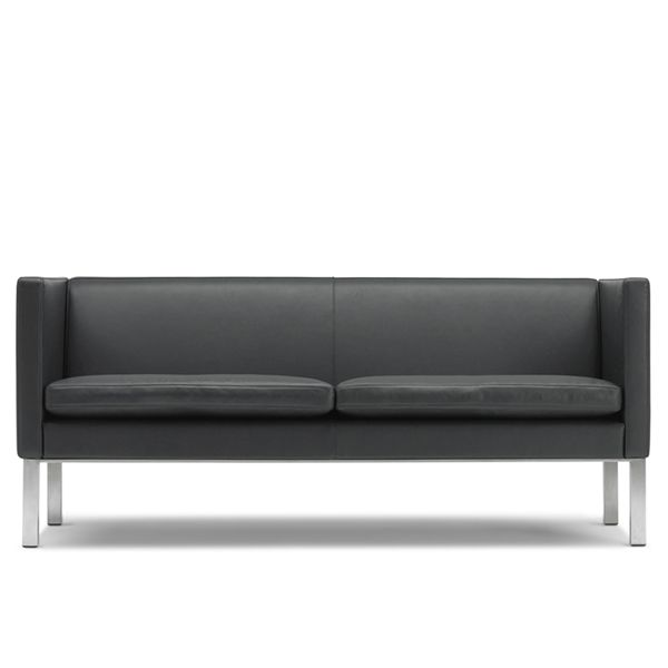 The EJ 50 sofa is designed by the EJ Design Team, the team of the Danish brand ErikJørgensen. It is characterized by its solid and precise seat and back, a minimalist interpretation of the sofa concept, inspired by cubism, from which it takes its shape. Details: Structure in chromed steel. Upholstered in leather of different qualities. Price for sofa model EJ 50-2 upholstered in black leather of group 1.See more details in NAHARRO