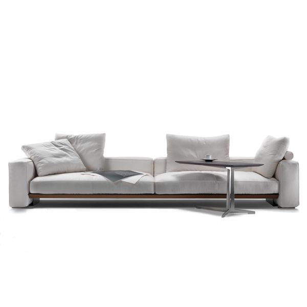 The Goodplace Sofa by Flexform is designed by Antonio Citterio with an enameled metal structure and a metal seat covered in leather in different finishes with a polyurethane mattress. The arms and backrest are made of polyurethane, dacron and feathers with a metal insert. The seat consists of feather cushions with an insert of non-deformable material, fabric cover or removable leather. The legs finish is available in satin, chromed, chrome or chrome metal.Details: 247 cm sofa upholstered in category fabric medium and 4 cushions (2 with curl and 2 without curl back) additional 50 x 50 cm.See in Naharro more sizes, modules, finishes and prices for the Goodplace sofa.