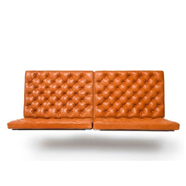 The PK26 suspended two-seater sofa was designed by Poul Kjaerholm for the firm Fritz Hansen in the 1956 year. Originally designed for the hall of Frederica's new town hall and mounted on the brick wall in front of the main staircase, it is a sofa with a huge presence with a design that took into account the architectural elements present. Details: Sofa wall 2 squares. Matt chromed steel base. Granulated foam cushion and Hairlok. Niger leather upholstery. Exclusive model, upholstered in Walnut leather.